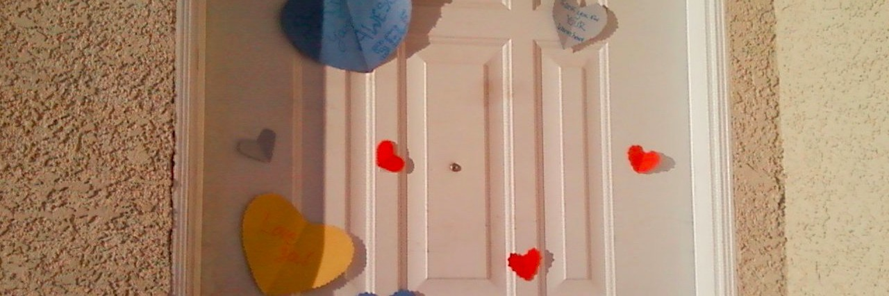 door covered with paper hearts