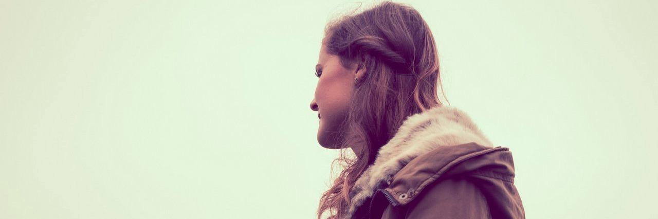 young woman staring into the distance