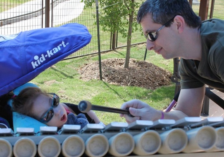 man plays xylophone for his daughter