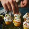 man making cupcakes