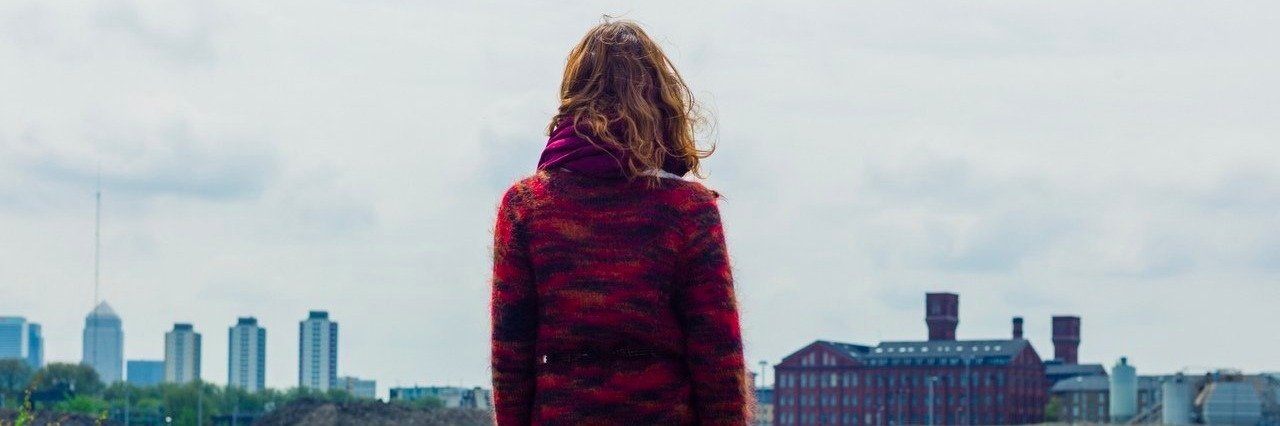 young woman looking at the city