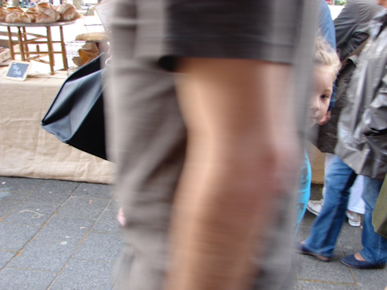 blurry arm with child peaking through