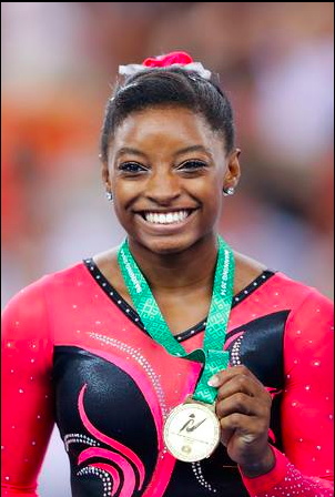 Simone Biles, Olympic medalist smiles with gold medal