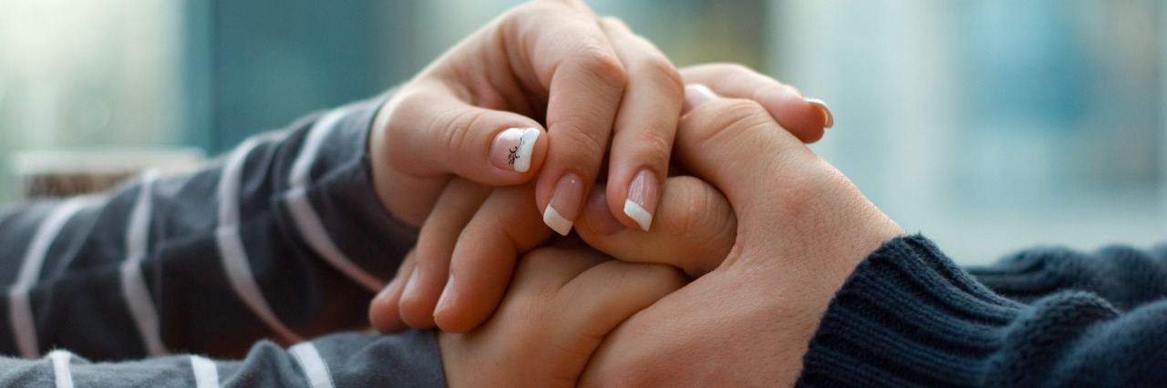 Man and woman holding each other hands.