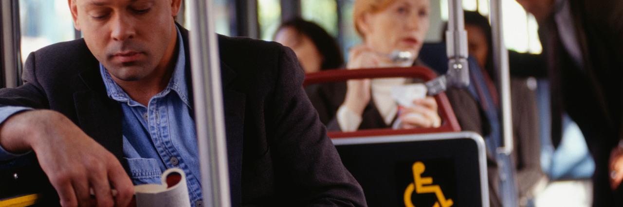 Passengers traveling on bus.