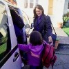 Mother taking daughter to school by car