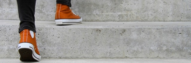 close up of man ascending stairs