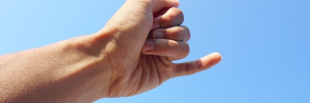 a hand reaching out for a pinky promise