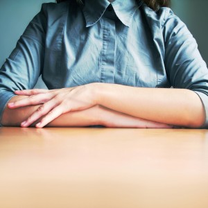 woman with her hands folded
