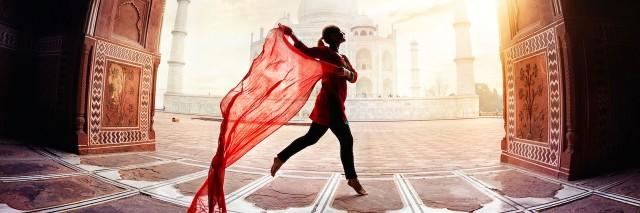woman dancing in front of the Taj Mahal