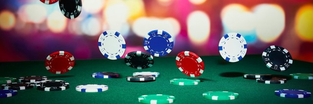 poker chips falling onto a poker table