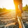 man walking on the train tracks