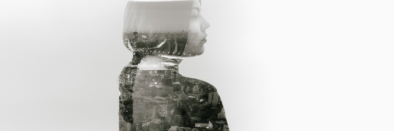 image of a woman with an image of a city
