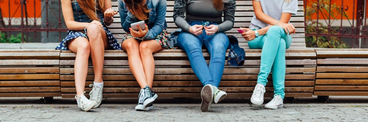a group of teenagers sitting on steps
