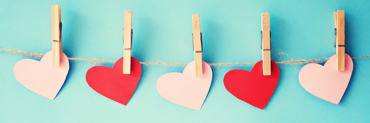 paper hearts hanging from clothespins