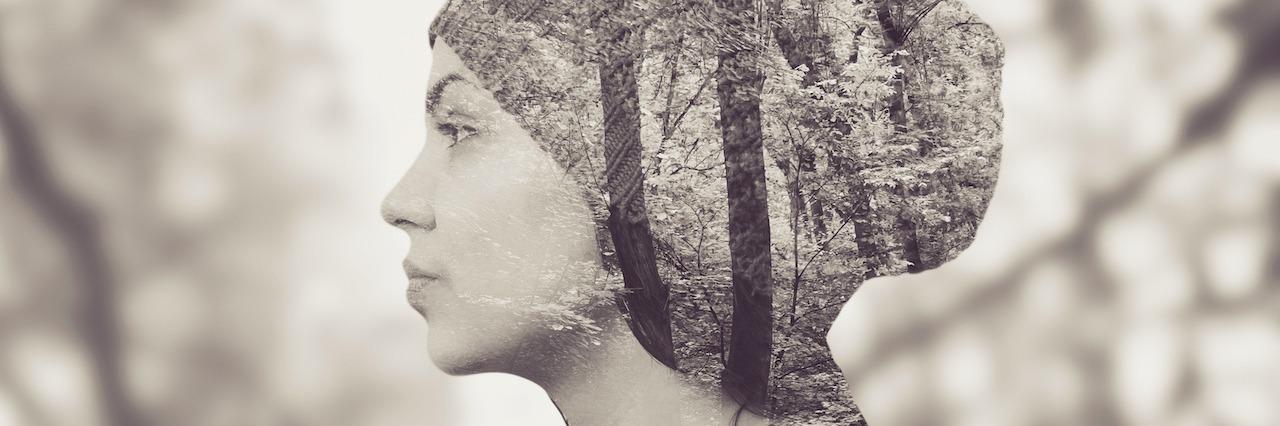 woman standing among trees