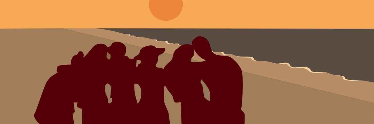 group of people at the beach at sunset
