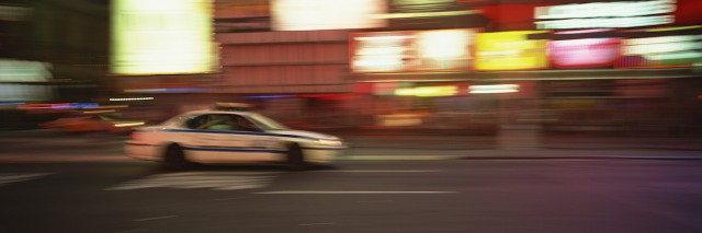 police car driving fast