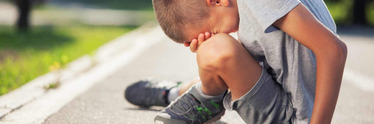 Boy crying after he lost run