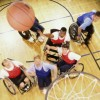 Athletes playing wheelchair basketball.