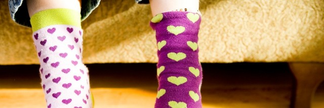 a childs feet clad in novelty socks