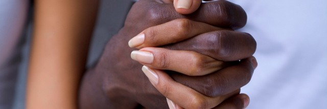 close up of male and female hands holding