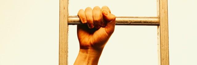 close-up of hands climbing a ladder