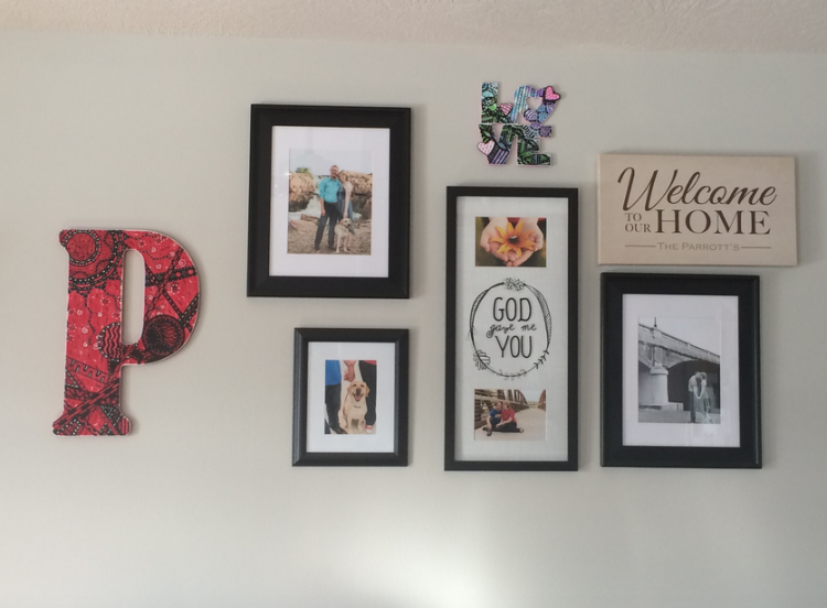 Pictures frames on a wall inside a house.