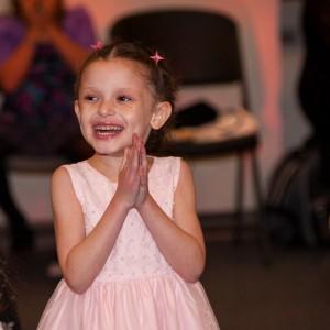 Deja, in a dress, smiling