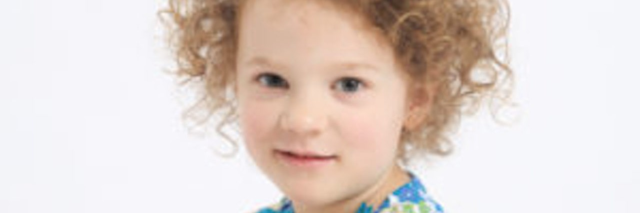 little girl with dirty blonde curly hair