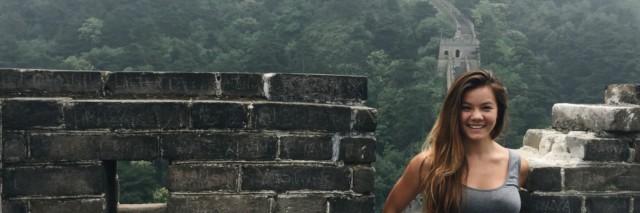 young woman posing at the Great Wall of China