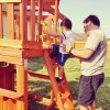 physical therapist helping boy up slide