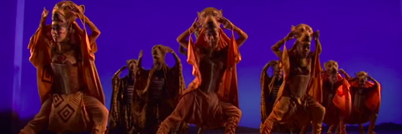 Scene from The Lion King on Broadway - performers dancing dressed as lions