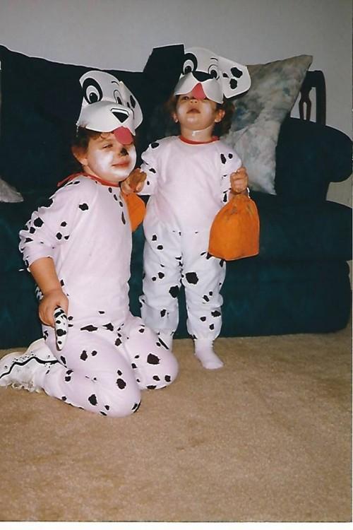two girls wearing dalmatian costumes for halloween
