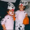 two young girls wearing dalmatian costumes for halloween