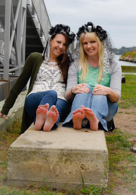 Melissa and Laura showing their red, painful feet