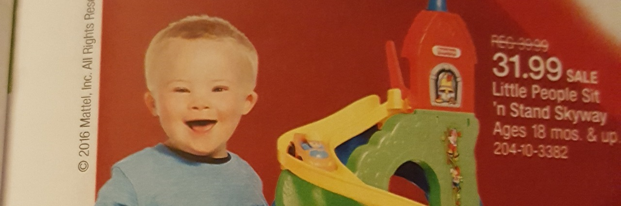 little boy with down syndrome in target's toy book