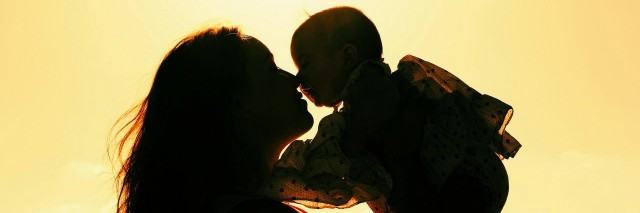 mother and baby at sunset