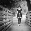 girl walking on a bridge