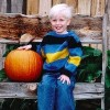 An older picture of Lisa's son, sitting next to a pumpkin