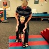 Gavin taking steps in physical therapy