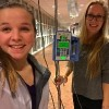 girl standing next to iv poll with a friend