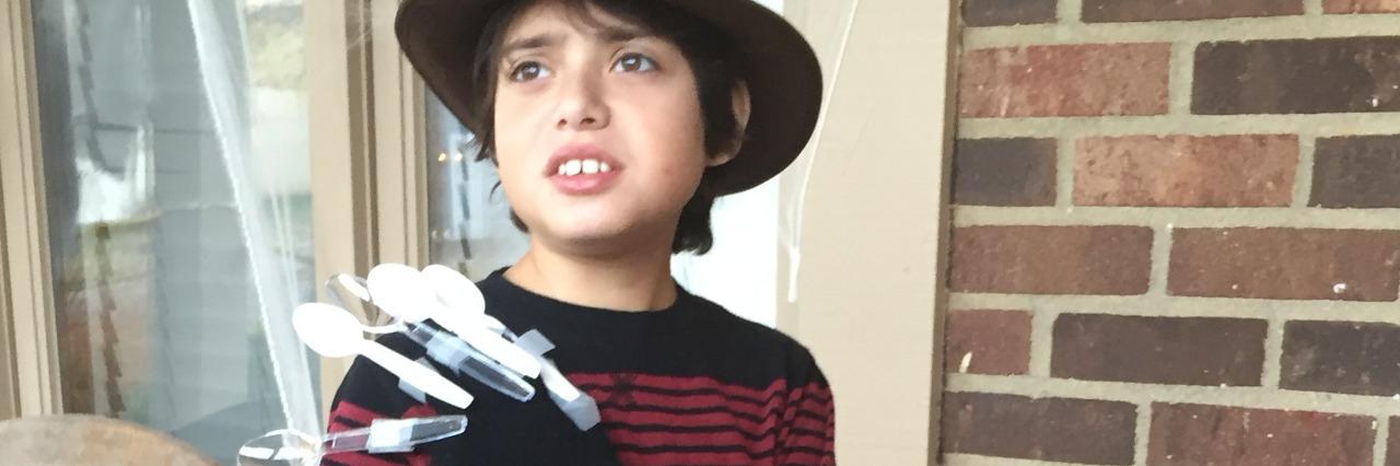 Boy dressed as Freddy Krueger.