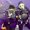mother and son scuba diving