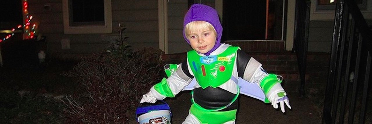 boy in Buzz Lightyear costume for Halloween