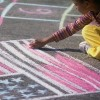 girl drawing the U.S. flag with chalk