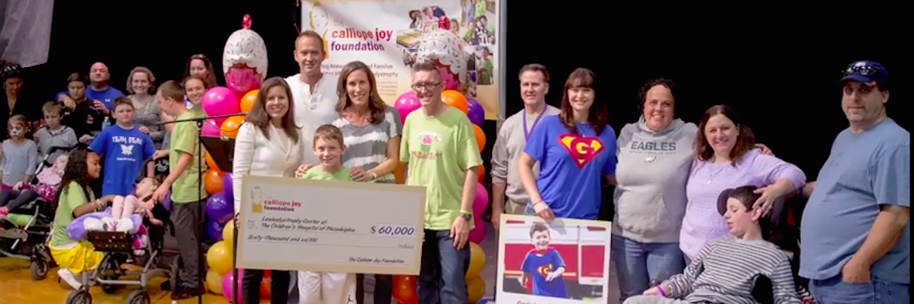 The Cal Foundation holding a check on stage