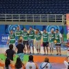 Photo of Slovenian athletes at the Special Olympics wearing their medals.