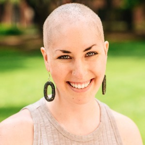 portrait of a woman with her head shaved