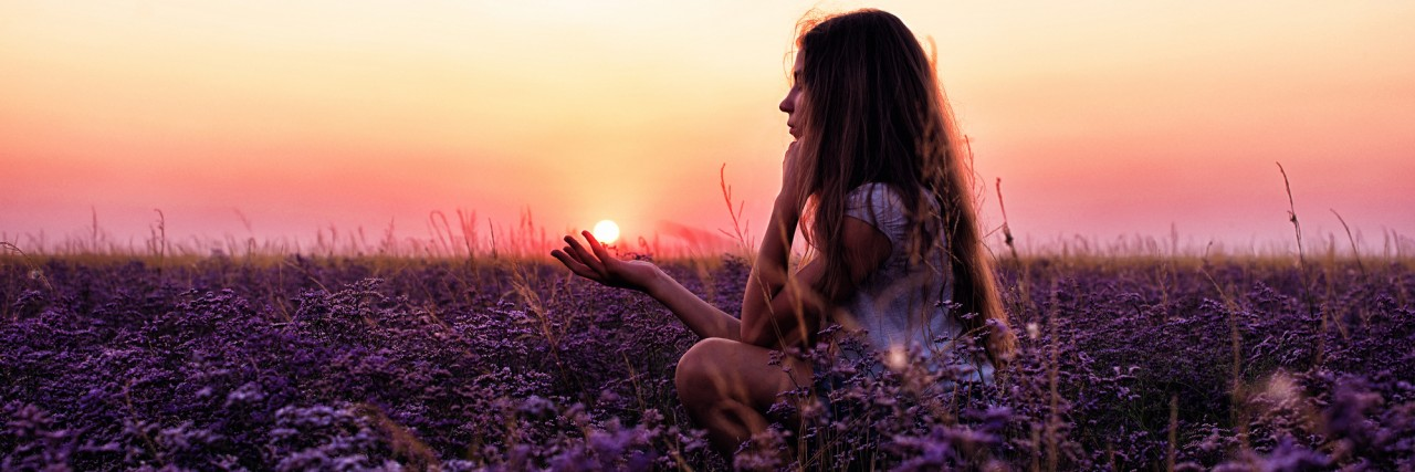 young girl in a field of purple flowers, pink sunset